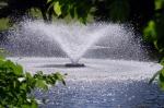 Fountain splashin down onto a pond